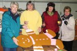 (From left) Jan Bauer, Deena Jones, Sarah Arney and Shirley Harwell were among those who spent hours painting gingerbread cutouts to raise awareness of homelessness.